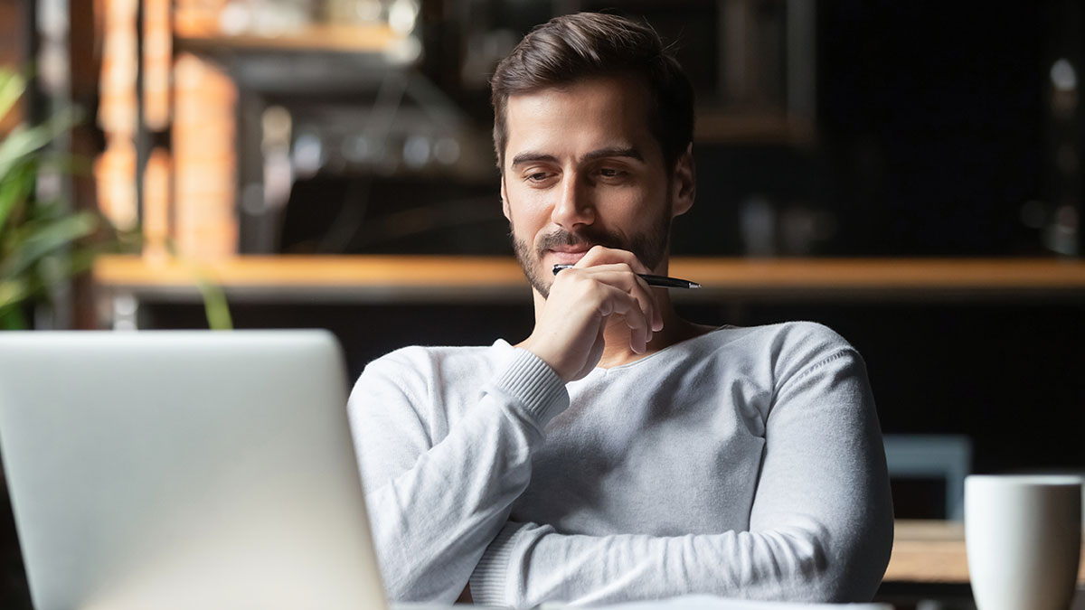 Man in front of laptop thinking about idea submission